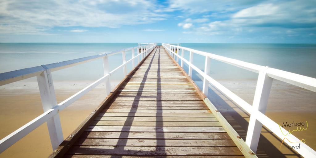 vakantiegevoel pier verdwijnt aan de horizin